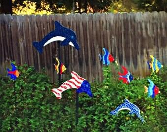 dolphin mosaics, pool mosaics, dolphin sculptures, tile mosaic dolphins, outdoor dolphin sculptures