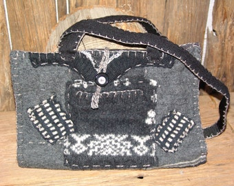 Handcrafted recycled fibers make up this unique purse