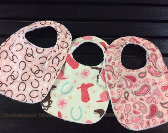 Western baby girl bibs in Rodeo Rider Round Up fabrics by Riley Blake