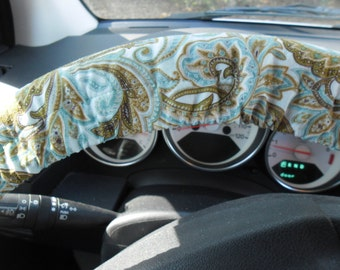 Teal and tan steering wheel cover, wheel cover