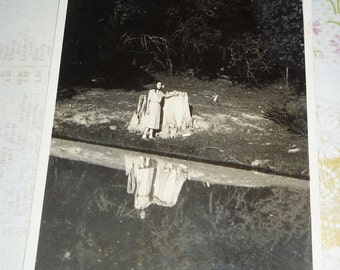 on sale Unused RPPC Woman in Longer Dress and Scarf Stands Next to Large Tree Stump - Reflection in Water