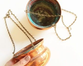 Set of two copper hanging planters.
