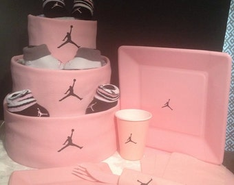 Faux leather Jordan themed diaper cake centerpiece with matching tableware