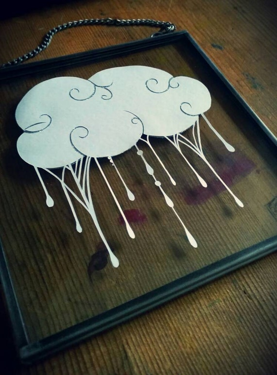Silver linings papercut. Framed cloud with glitter.