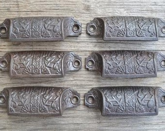 A set of 6 Eastlake style cast iron drawer pulls AL17