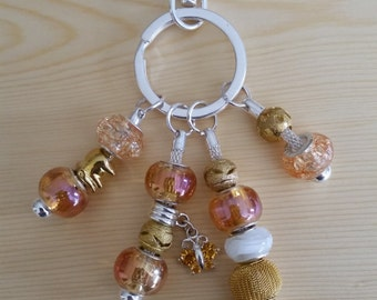 Gold key chain or hand bag charm