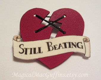 Broken Heart Still Beating Scroll Banner Shrink Plastic Pin