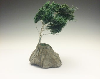 "Windswept wire bonsai tree ""planted"" in stone"
