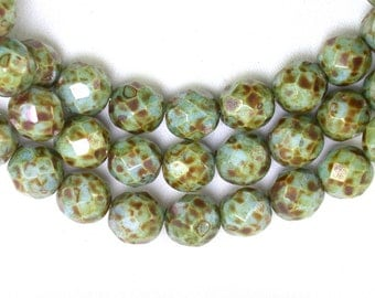Pale green opaque w/ soft luster and picasso finish 8mm firepolish rounds. Set of 25 or 50.