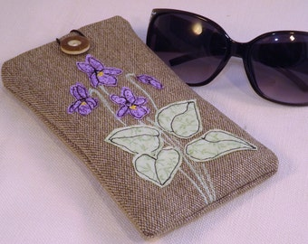Glasses, sunglasses case with violets applique and free motion embroidery.