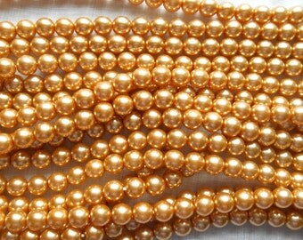 50 6mm gold glass pearl druk beads, golden Preciosa Czech round, smooth glass pearls C5750