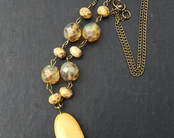 Beaded, pendant necklace with a bohemian flair
