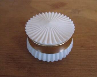 "1970s Avon ""Nearness"" cream sachet container, empty"