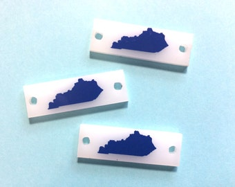 1.5 Inch Two Hole Blue Kentucky Blanks on white planks - made for wire bangle bracelets and jewelry making necklaces personalized mono
