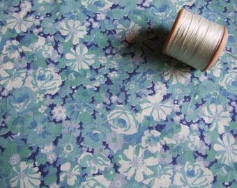 Blue floral cotton dressmaking fabric