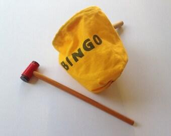 Vintage yellow bingo bag and hammer from Dutch 70s bingo game