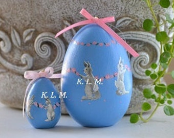 """Easter Egg,handpainted with """"Dancing Bunnies"""" pink flower garland on baby blue background"""