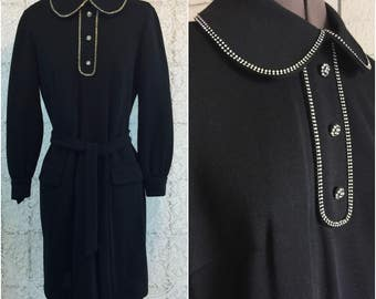The perfect little black dress! Jet black poly-wool blend with rhinestone accents. Size medium to large.