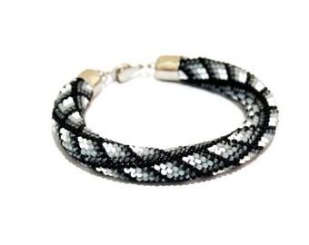 """Beaded bracelet """"Black-and-white sparks"""""""