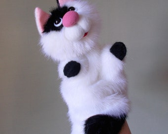 Cat. White - black cat. Puppet theatre. Toy glove. Bibabo. Toy on hand. Marionette.