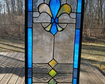 Stained glass panel with blue fleur de lis