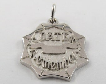A Date to Remember Sterling Silver Charm.