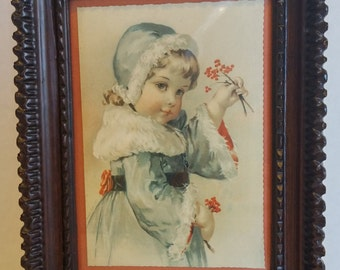 Beautiful Vintage Winter Picture of a Girl Holding Red Berries