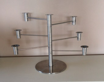 Stainless steel candelabra with moveable arms. Made in Switzerland.