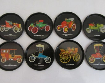 Set of Eight Black Metal/Tin Drink Coasters with Multicolored Old Cars - 1950s.