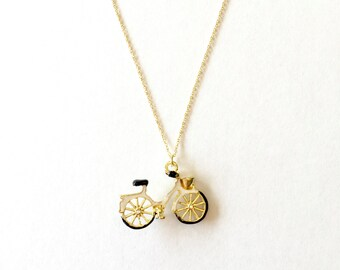 white & gold bicycle necklace on gold dainty chain