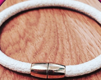 Leather bangles with a magnetic clasp.