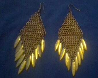 dangling festive gold earrings