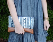 Zippered clutch with leather accent. Handheld bag. Patterned fabric pouch.