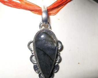 Lovely handcrafted silvertone laboradite pendant on organza