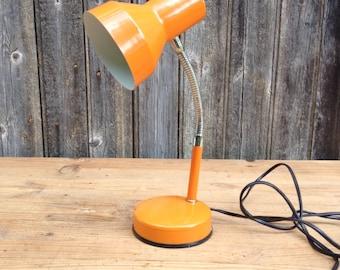 Desk lamp or bedside lamp, orange, on Italian design 1970 Veneta Lumi.