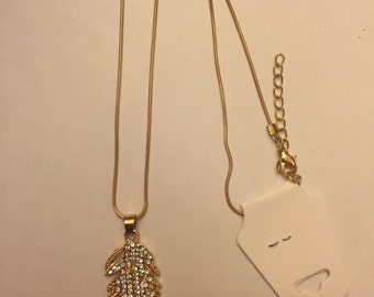 Gold feather necklace with rhinestones.