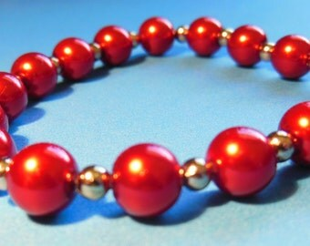 Red and silver elastic beaded bracelet