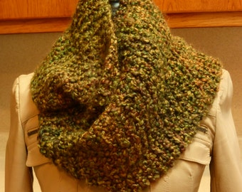 Handmade knit chunky infinity green scarf with hints of orange, gold and brown in a ribbed finish.  Free domestic USPS priority shipping!