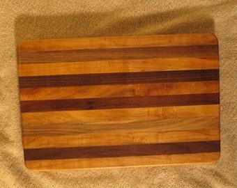 Walnut,elm and cherry wood cutting board