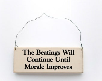 Wood Sign Saying The Beatings Will Continue Until Moral Improves.