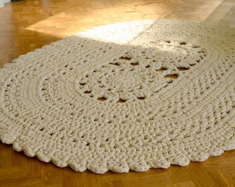 Big natural white oval crocheted rug