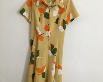 Vintage early 1970s A-line dress in mustard/ bold leaves print