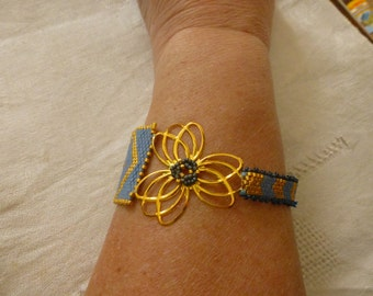 asymmetrical strap blue and gold