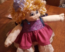 Sculpture soft formed handmade doll. Blonde curly hair blue eyed. Pink