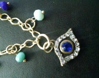 blue eyed gold charm bracelet