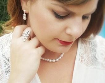 Faux Pearl Rhinestone jewelry set Earrings, Necklace, And Bracelet