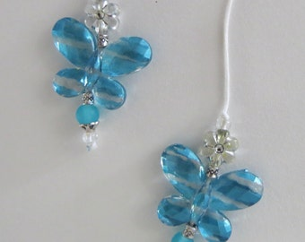 String Beaded Butterfly Bookmarker in teal blue acrylic.