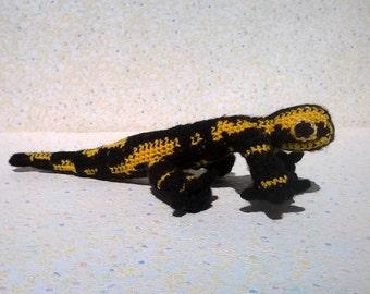 Salamander, yellow and black, type amigurumi, crocheted hand