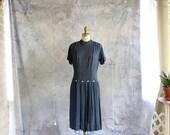 1960s drop waist gingham plaid dress with pleated skirt . black & blue plaid dress . medium