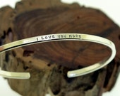 I Love You More, sterling silver cuff bracelet by Kathryn Riechert